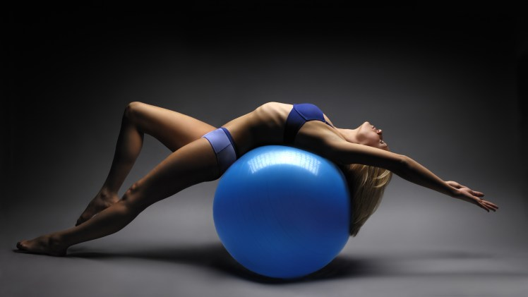 girl-training-on-gym-ball_188