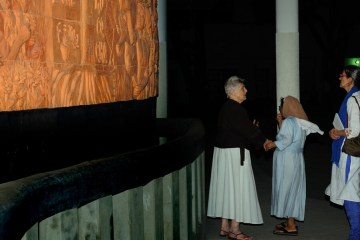 Sr. Joseph Mary shows Cathy some of the art at Holy College.  Photo by Anil Advani.