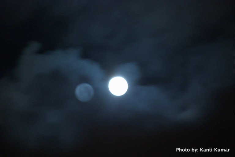 Double moon in clouds