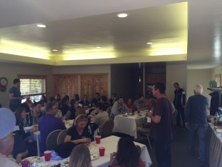 Joel addresses the group during lunch