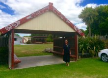 Cynthia Lee Sinclair stands at the entrance of a marae, a sacred meeting grounds for Maori –Cynthia Lee Sinclair