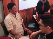 Chuck Furuya jokes with staff at Vino Italian Tapas and Wine Bar in Honolulu – Courtesy of Storm Cruz