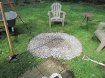 Adding gravel and hand tampering to level it out