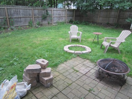 Laying out the initial shape - I put sand around the stones to mark it. You can see the old firepit to the right.