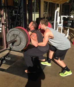 Gabe lifting with spotter