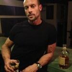 Gabe with a glass of Scotch