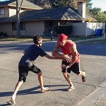 Gabe and son playing football