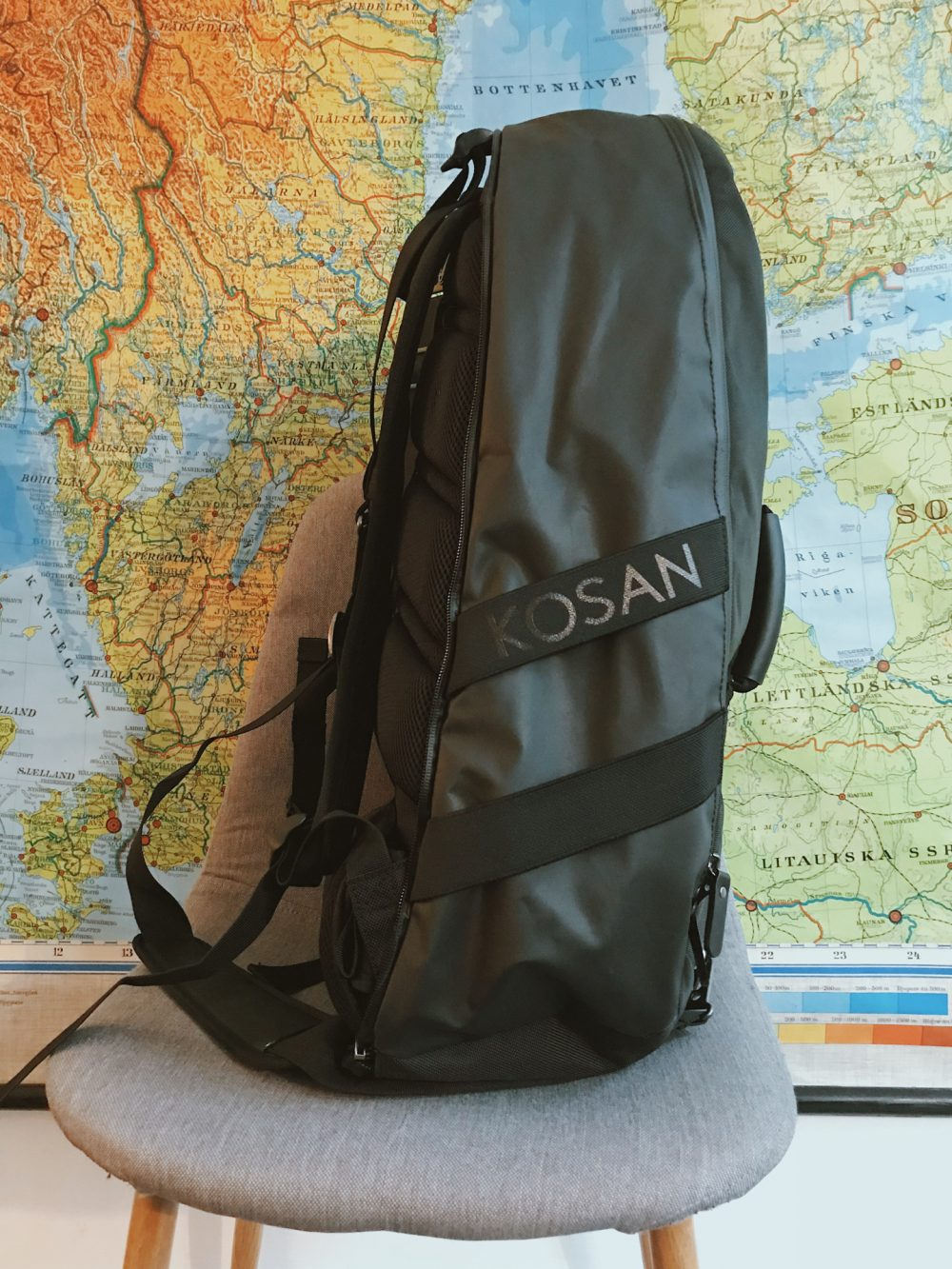 A black hiking bag on a chair