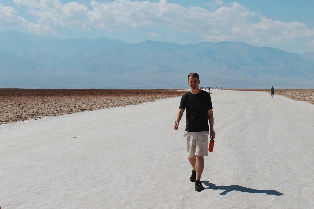 A boy walks on the salt flats in Death Valley