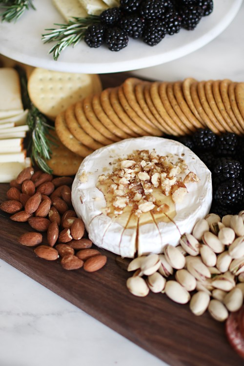 How to make a simple and beautiful charcuterie board. Get all of the ins and outs and how to wow those you are entertaining over at Haus of Layne! #CharcuterieBoard #HowToMakeACharcuterieBoard #BeautifulCharcuterieBoard #SimpleCharcuterieBoard #HowToMakeACheeseBoard #EntertainingTips #PartyIdeas #AppetizerRecipe #EasyAppetizerIdeas