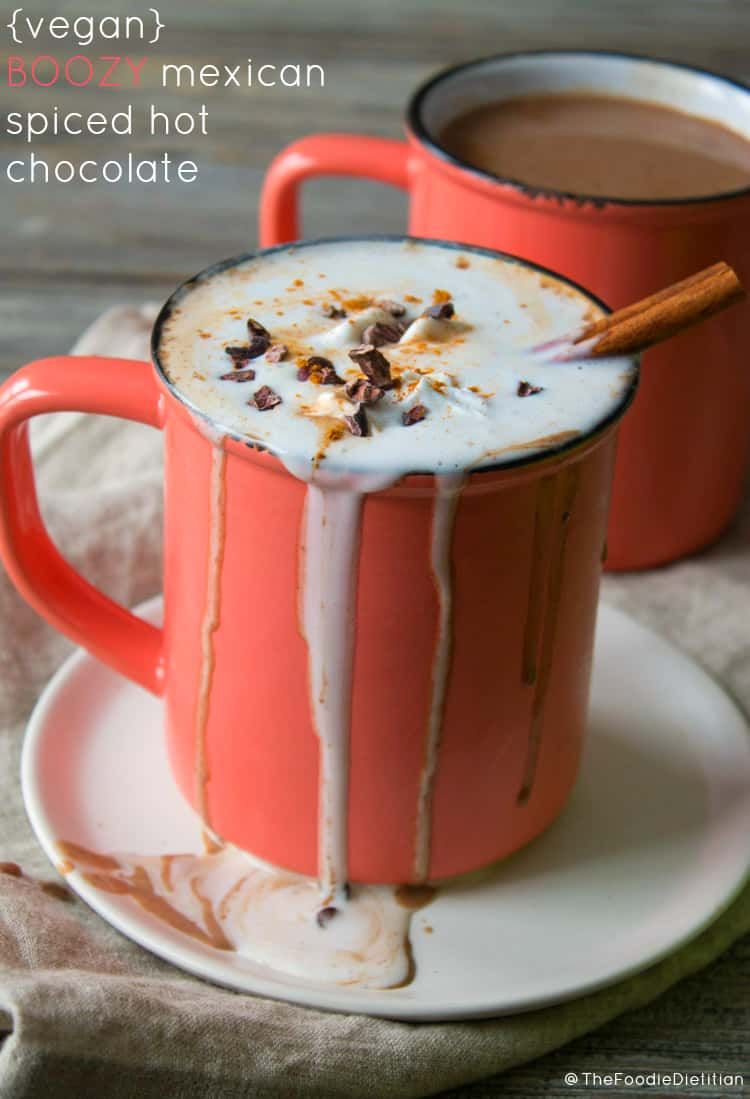 This vegan boozy Mexican spiced hot chocolate is perfect for a Valentine's Day date night or to get cozy with on any cold, blustery winter's night. Sweet, spicy and boozy. What more do you need? | @TheFoodieDietitian