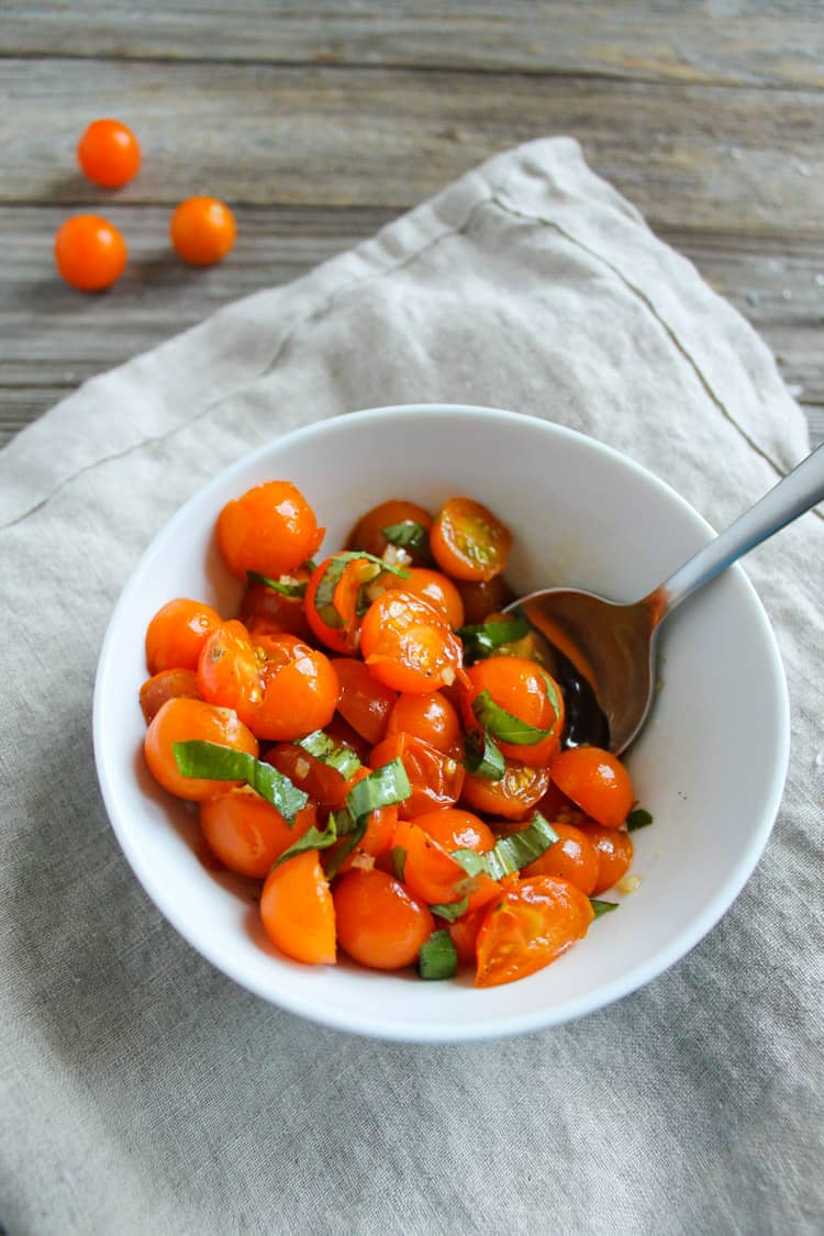 You know it's the end of summer when you eat tomato salad everyday. My Easy 5 Ingredient Tomato Salad takes less than 5 minutes to make. The perfect light and fresh end-of-summer appetizer.