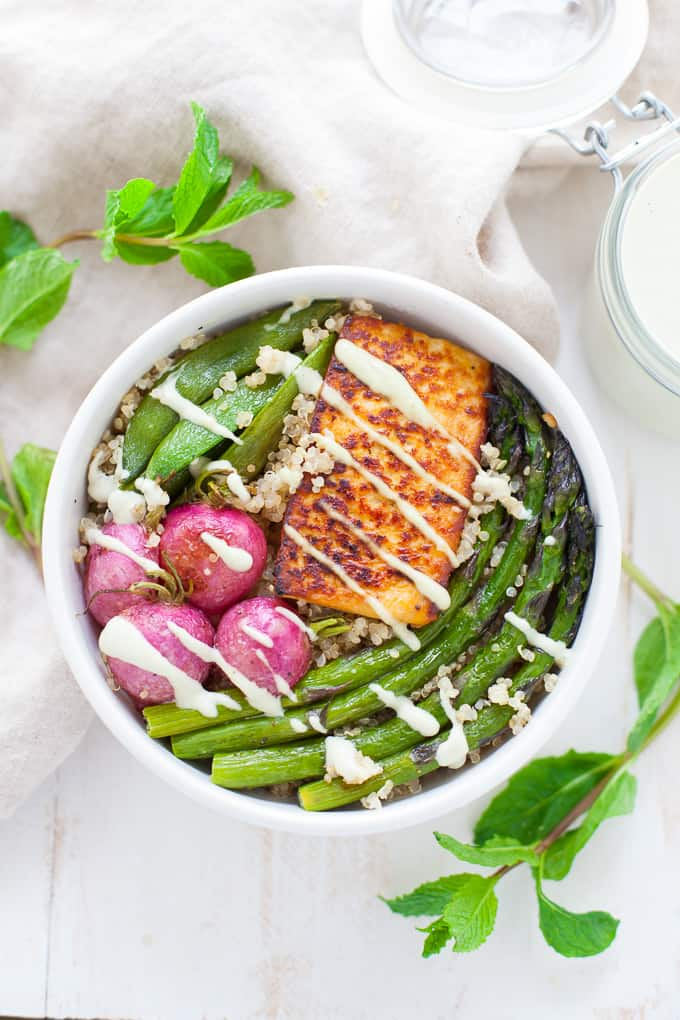 A delightfully refreshing and seasonal dish, this vegan-friendly spring vegetable buddha bowl is packed with seasonal veggies, tofu and a minty creamy cashew dressing.