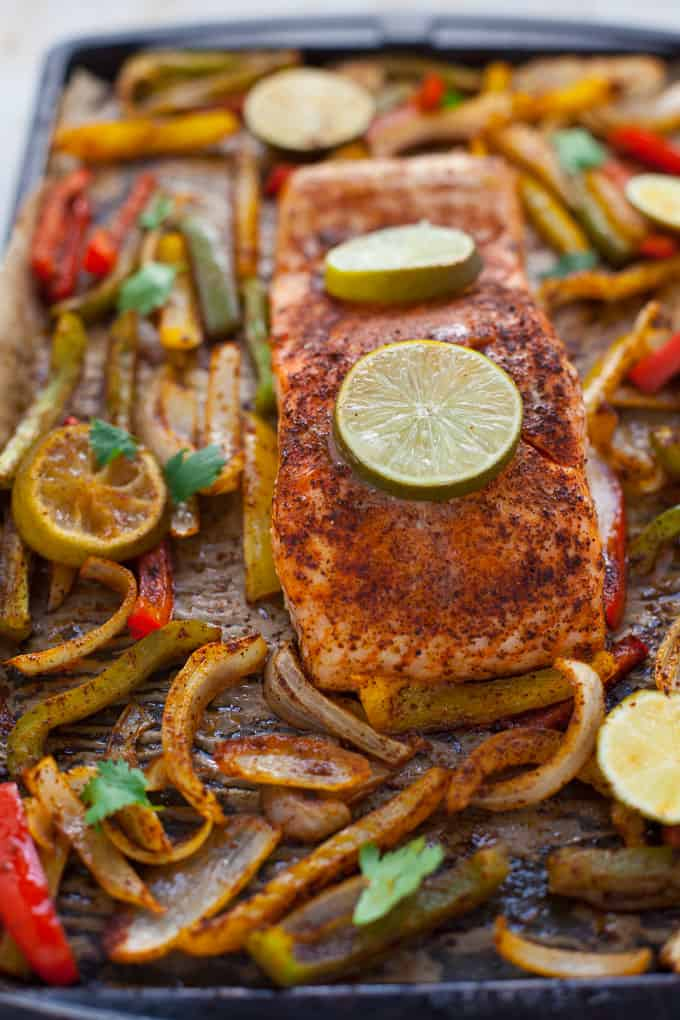 These gluten-free sheet pan salmon fajitas are perfect for a quick weeknight dinner with minimal cleanup! Can you say Taco Tuesday? Or, better yet, Fajita Friday??