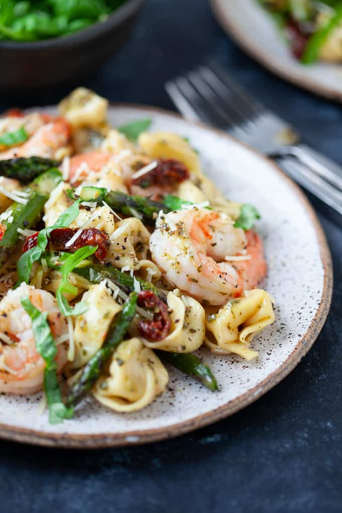 The perfect weeknight dinner, this Three Cheese Tortellini with Pesto Shrimp and Asparagus comes together in less than 30 minutes.