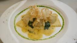 Ravioli with basil butter sauce