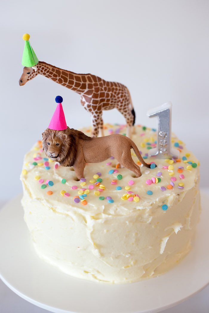 5 Easy Ways to Decorate a Birthday Cake // Just make a quick pit stop at the closest toy store - or Dollar Tree! - and pick up an inexpensive pack of theme-appropriate miniatures. Easy cake decorating idea! // BumbleBits.co