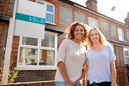 Women standing outside sold house