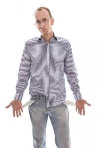 Man in jeans with empty pockets has no money to pay child support.