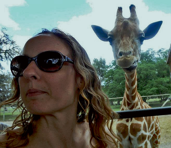 Giraffe making faces behind my back