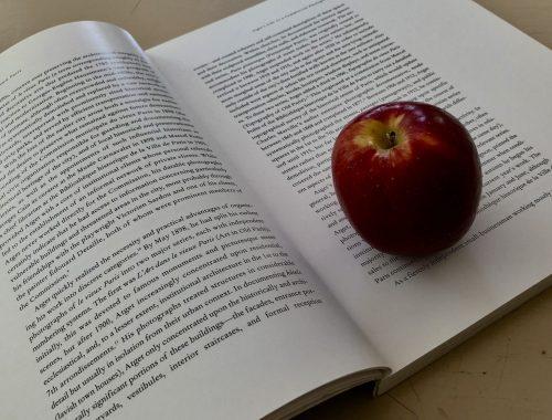 Apple and Book, Why I Wrote a Novel About a Weird Apple: Part 1, Karen Hugg, https://karenhugg.com/2018/06/17/protagonist-setting #novel #writing #protagonist #setting #story #plants #apple