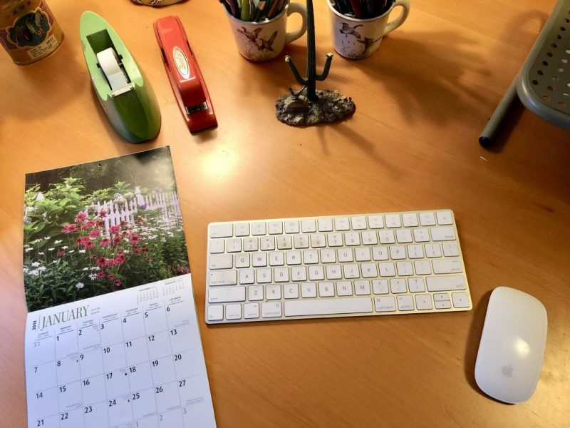 Desk With Calendar, The Weird Magic of Intention in my 2018 Year, Karen Hugg, https://karenhugg.com/2019/01/04/weird-magic-of-intention #writing #books #novel #writinglife #NewYearsResolution #intention