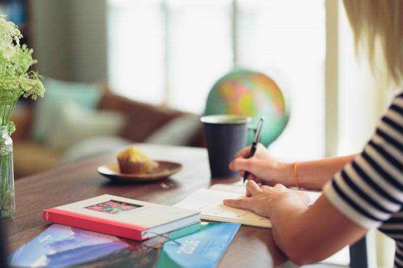 Woman Writing, The Importance of Writer Tribes in a Creative's Life, Karen Hugg, https://karenhugg.com/2019/06/03/writer-tribes/ #writing #writers #writerslife #writertribes #writinggroups #solitarylife #craft #books #fiction