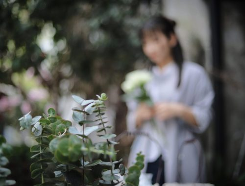 Woman and plants, Does Being in Greenery Alleviate Covid Depression? Daily Stress ReLeaf, Karen Hugg, https://karenhugg.com/2021/03/12/greenery-and-depression #covid #depression #greenery #trees #plants #destressing #anxiety #mentalhealth