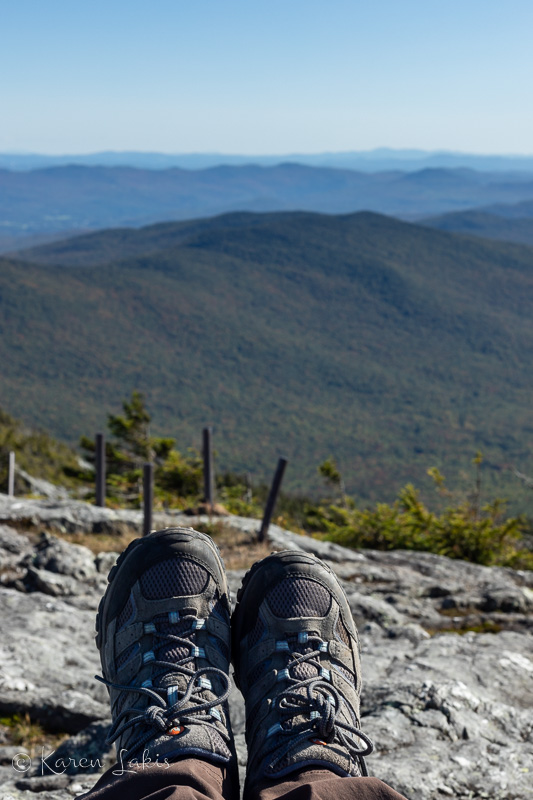 looking over my hiking boots at the top of Jay Peak