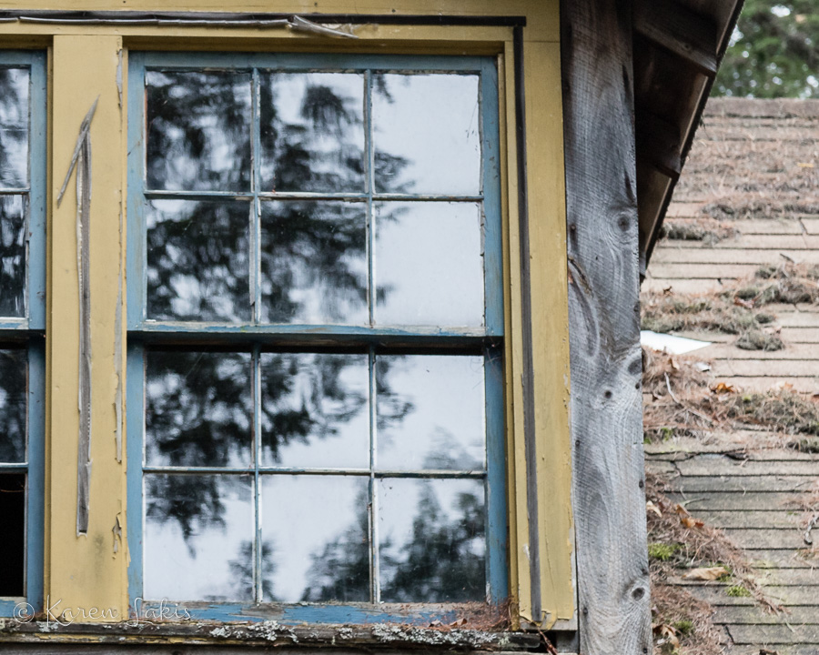 old window of abandoned cabin