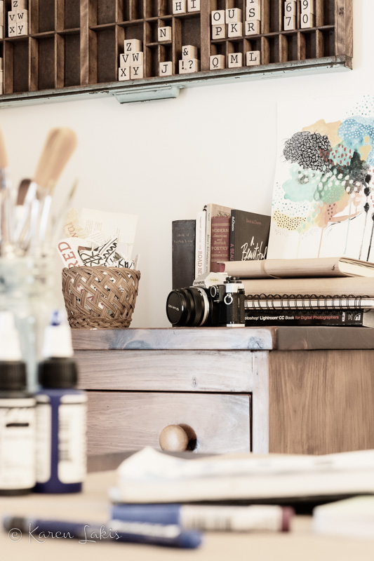 looking past desk to dresser with books