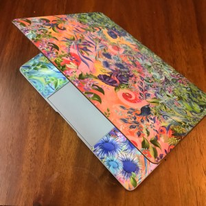 back of laptop with colourful vinyl
