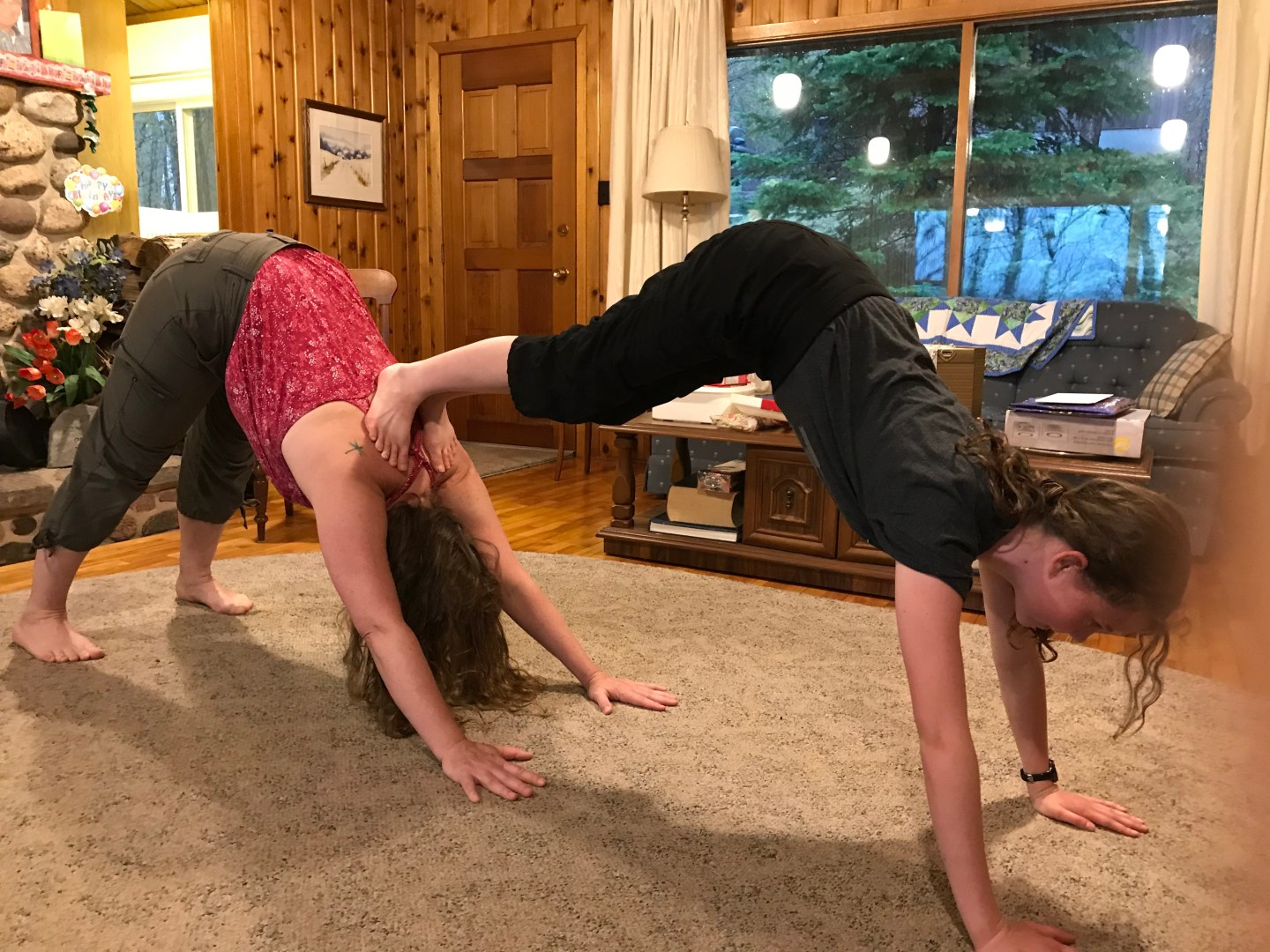 me and my daughter in downward dog pose