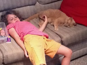 girl and cat on couch