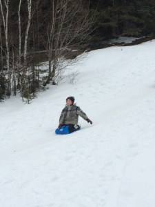 boy on a toboggan