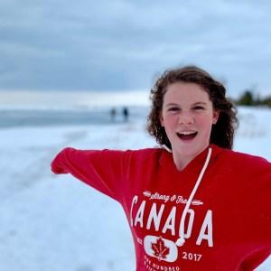girl wearing red Canada sweatshirt