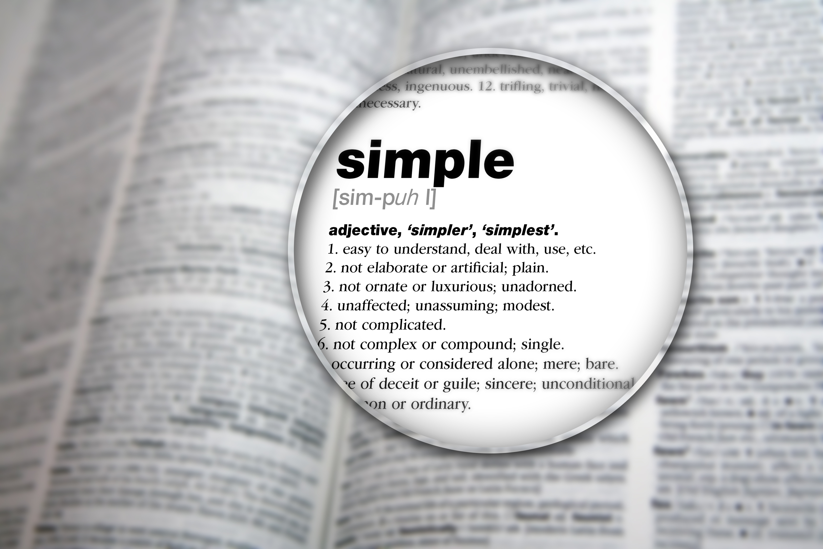 "magnified image of the word ""simple"" in the dictionary"