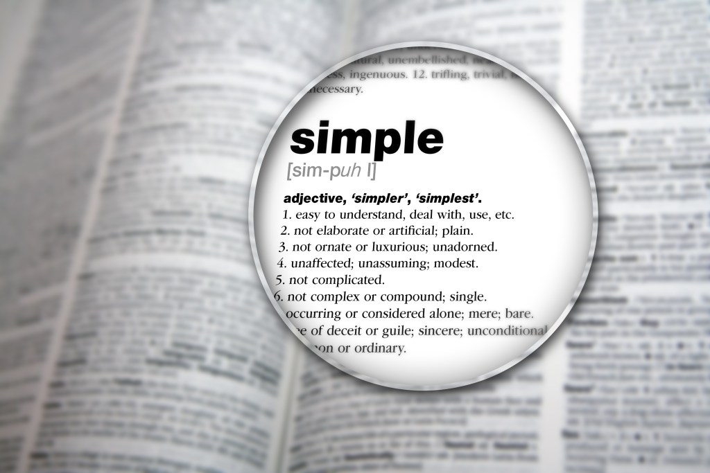 """magnified image of the word """"simple"""" in the dictionary"""