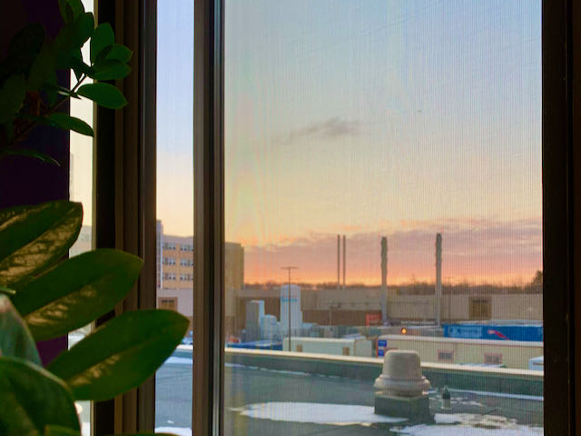 sunrise from office building window