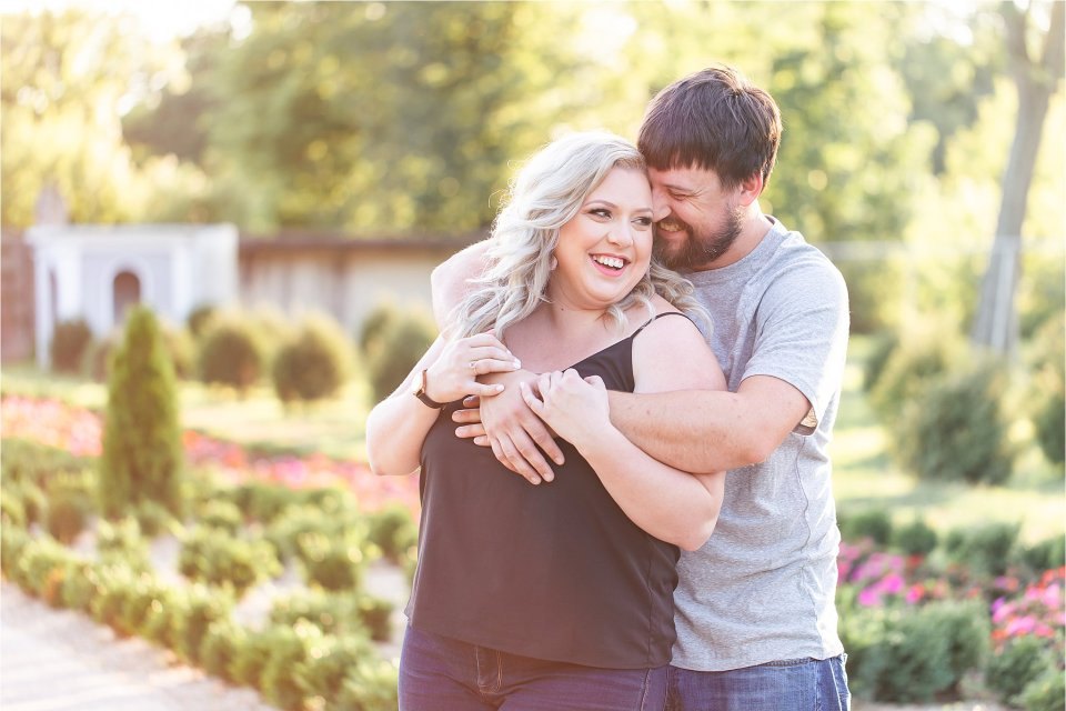 Couple laughing in gardens during engagement session at Allerton Park in Monticello, Illinois | Karen Shoufler Photography