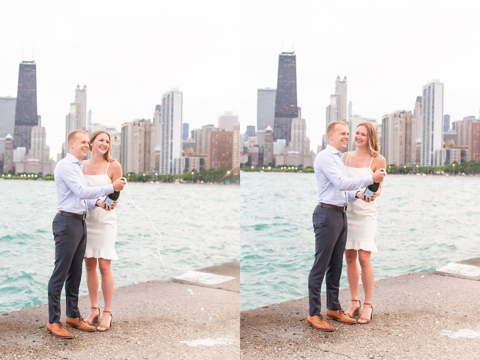 Beautiful couple popping champagne at North Avenue Beach with Chicago Skyline engagement photos by Karen Shoufler Photography