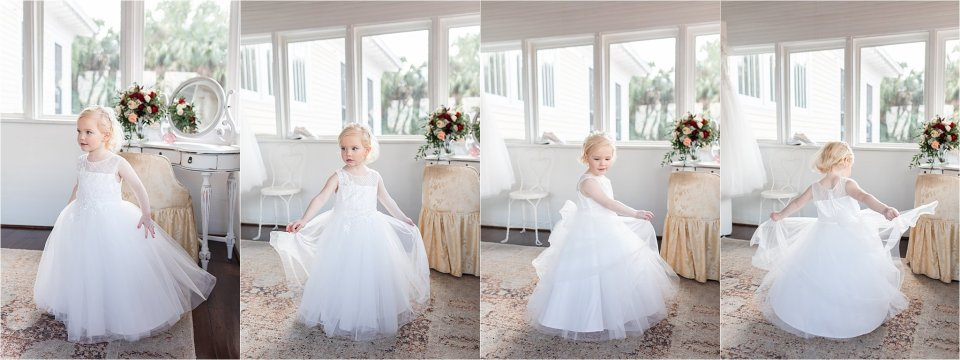 Flower girl twirling at Heitman House wedding venue in Ft Myers, Florida