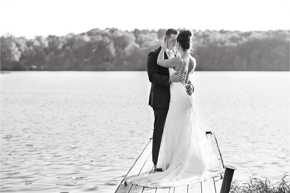 Bride and groom black and white on dock at Lake of Egypt by Karen Shoufler Photography
