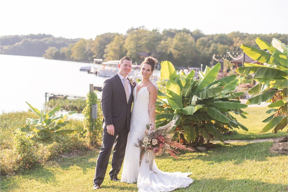 Bride and groom by lake at Egyptian Hills Resort