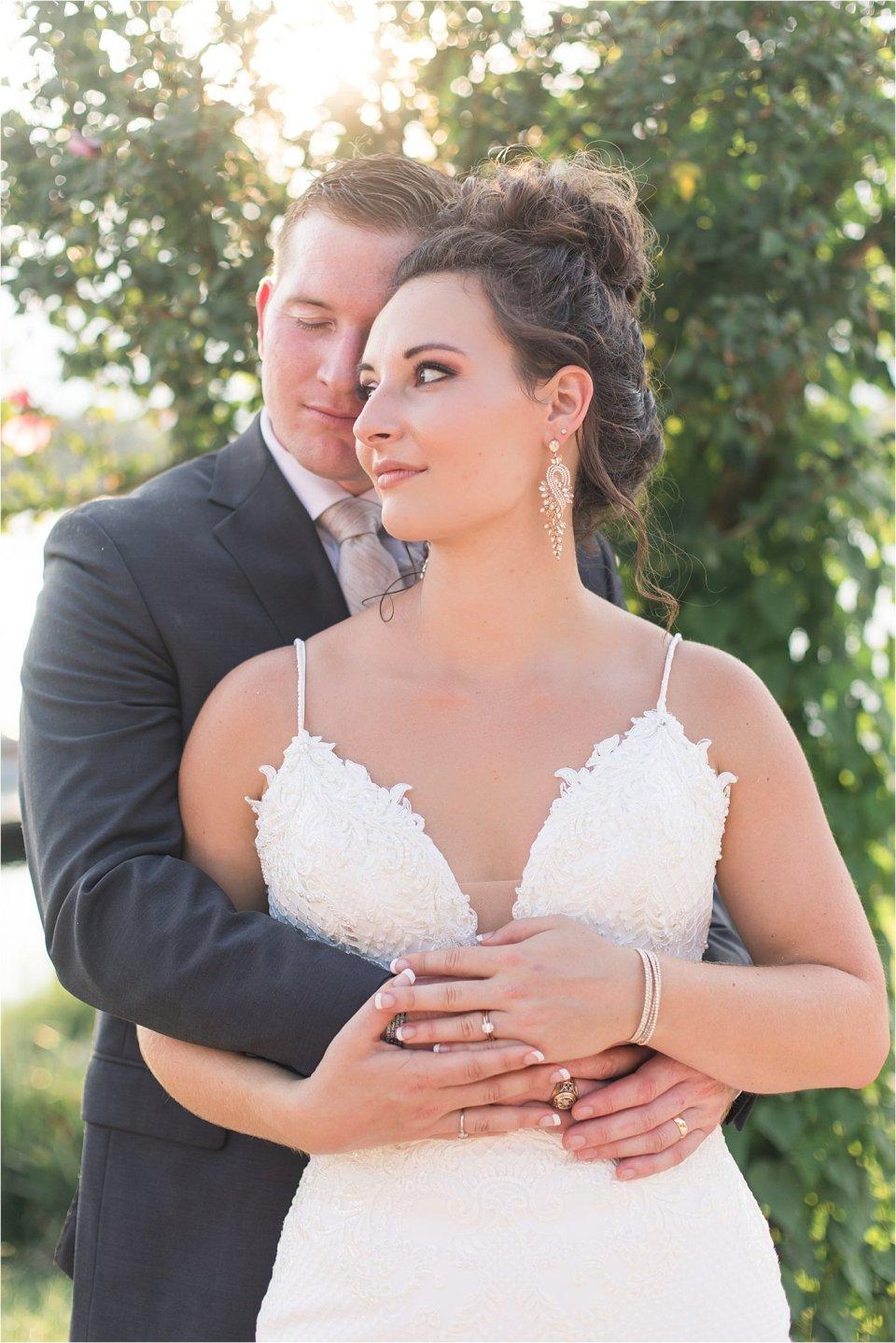 Groom holding bride at Lake of Egypt wedding