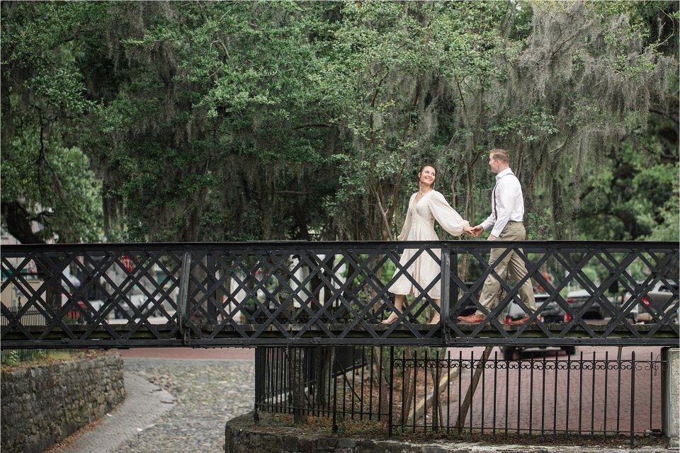 Couple on bridge in downtown Savannah, GA by destination photographer Karen Shoufler