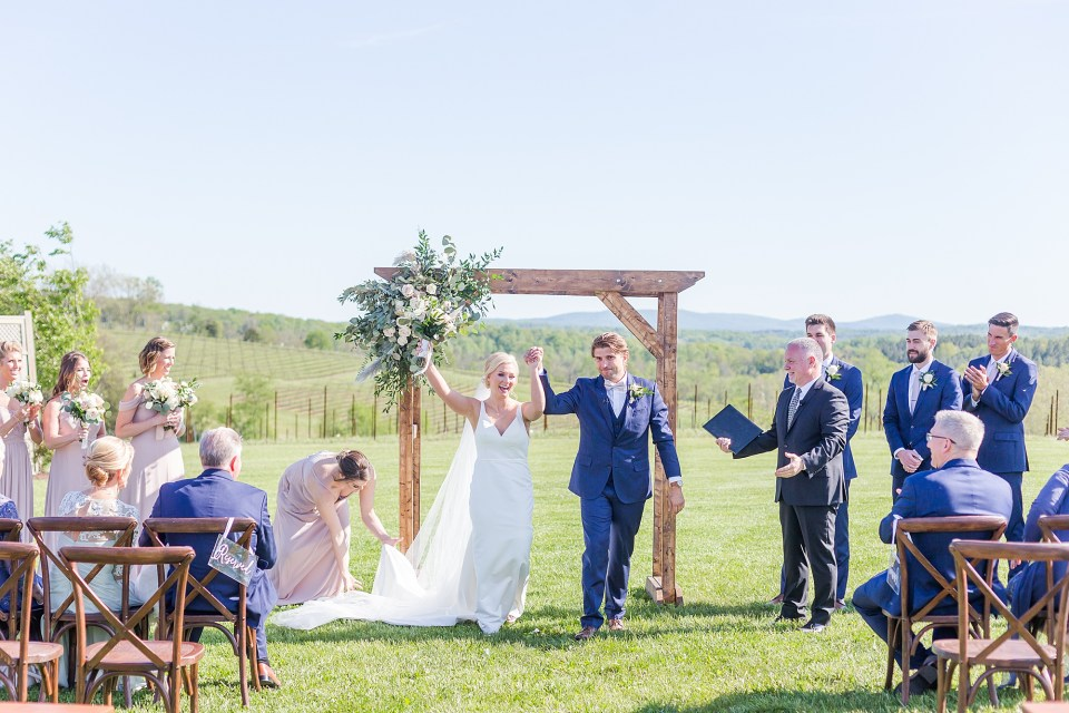 Wedding ceremony on the hillside at Stone Tower Winery wedding