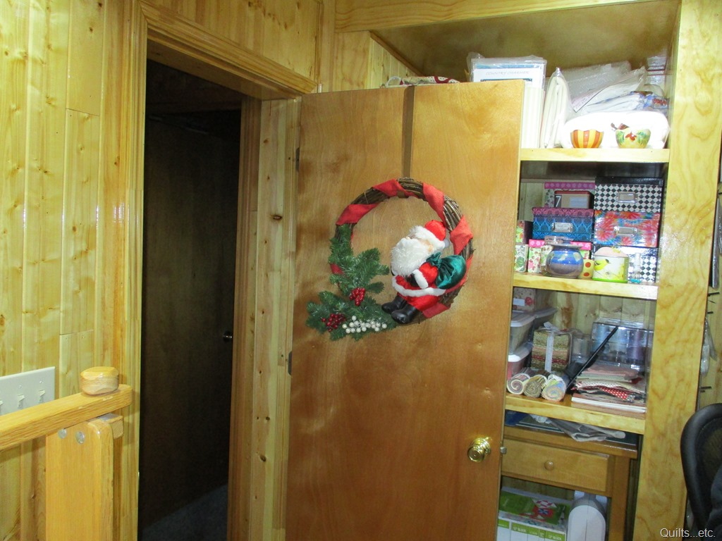 A Christmas wreath that had belonged to my mother-in-law -- now hanging on the door to the sewing room