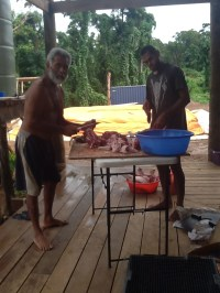 Charlie and Arthur butchering the pig