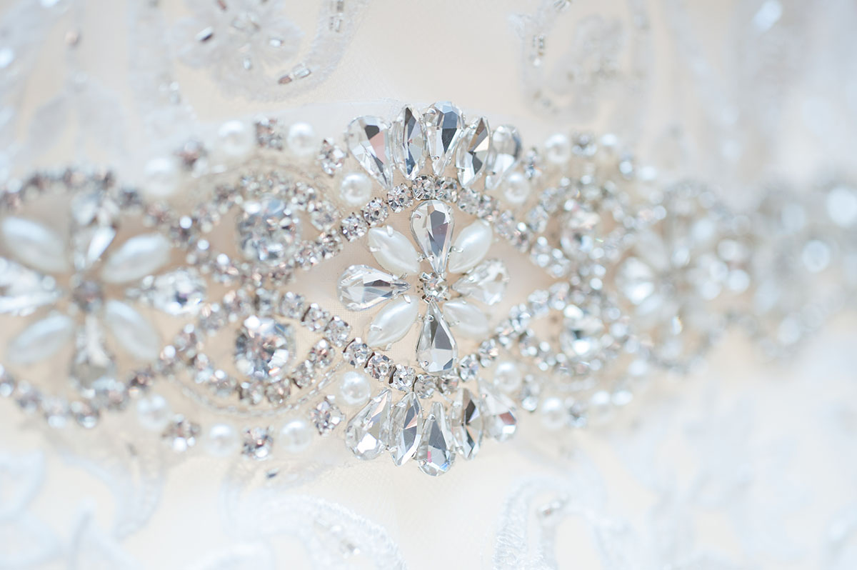 Wedding portfolio - pearl and crystal jewel motif on the front of a white wedding dress